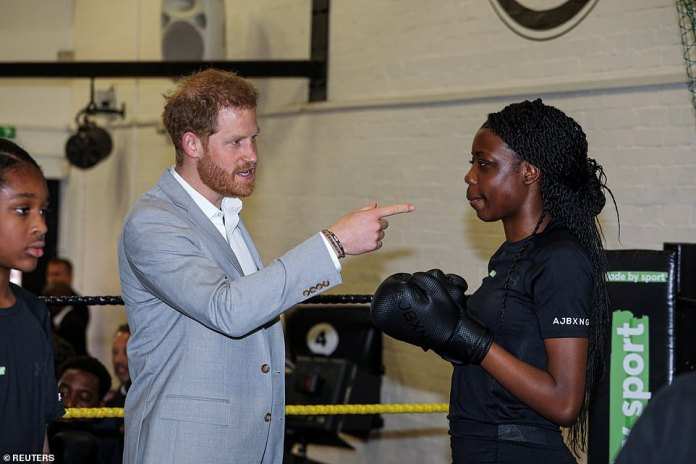 Prince Harry gestures as he attends the launch of Made by Sport. He sparked up a conversation with one of the youngsters attending the boxing session which was run by Nicola Adams and Anthony Joshua