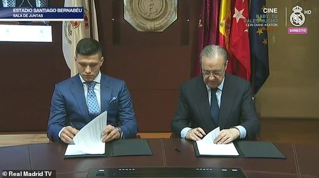 He was pictured on Real Madrid TV signing his contract with alongside Real chief Perez