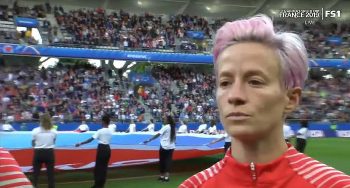 The 33-year-old midfielder stood silent and stony-faced as the 'Star-Spangled Banner' blared out across the Auguste-Delaune Stadium in Reims