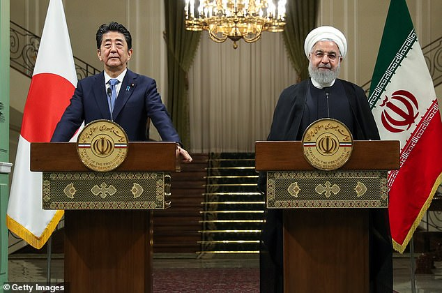 Japan's leader Shinzo Abe speaks with Iranian president Hassan Rouhani (right) in Tehran yesterday. Mr Abe warned of an 'accidental conflict' in the region