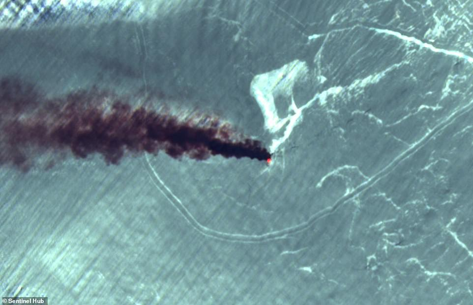 This satellite image shows the view from above as a fireball erupts from one of the oil tankers in an apparent attack today