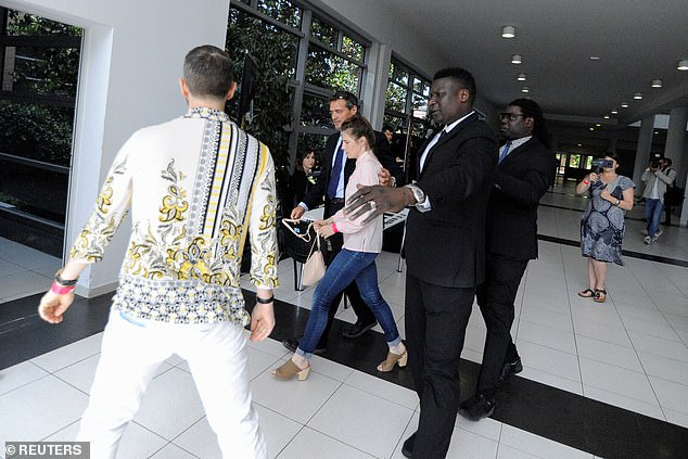 Knox attracts attention as she leaves the conference after the first day of the Criminal Justice Festival in Modena