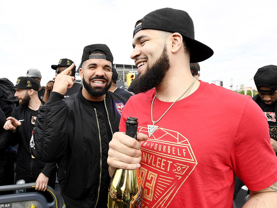 Raptors guard Fred VanVleet, right, celebrates with performing artist Drake