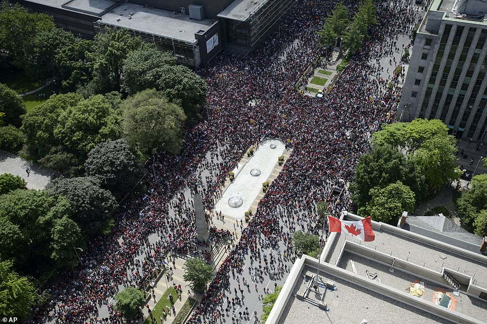 Fans filled the intersection of Queen St. West and University Avenue during Thursday's parade through the streets of Toronto