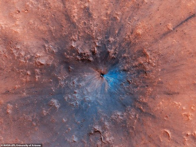 A 50-foot-wide impact crater has appeared on the surface of Mars. In a jaw-dropping photo captured by the High Resolution Imaging Science Experiment (HiRISE) instrument on NASA's Mars Reconnaissance Orbiter, the new crater appears an explosive feature on the dusty surface