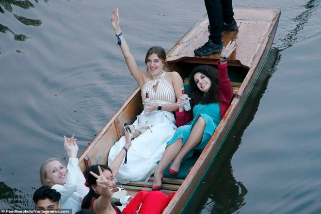 Some revellers continued drinking after the May Ball as they took a daylight punt on the River Cam in the early hours of this morning
