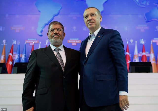 Erdogan, right, and former Egyptian President Morsi together at a press conference in 2012