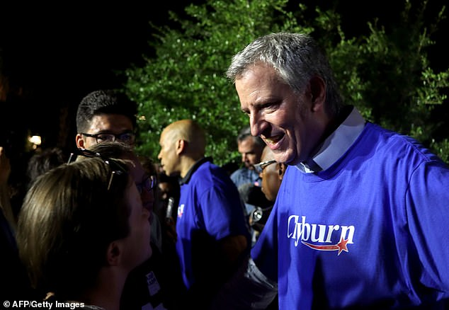 New York Mayor Bill de Blasio, seen on Friday night at a South Carolina Fish Fry, is among the local officials who are vowing to do everything in their power to stymie enforcement