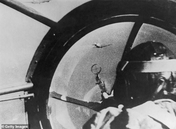 Aerial battle: A Spitfire flies past the window of a German Heinkel HE-111 bomber, 1941