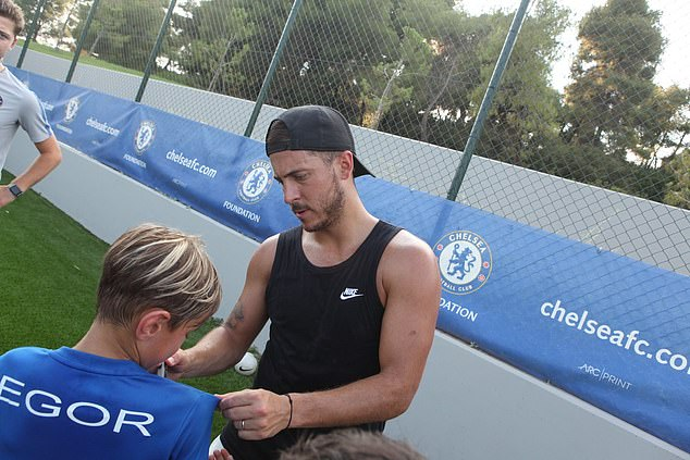 Hazard ran around with the kids in training, posed for a group photo, and signed their shirts Hazard back among Blues as he visits Chelsea Hazard back among Blues as he visits Chelsea 15324398 7187763 image a 17 1561633524394