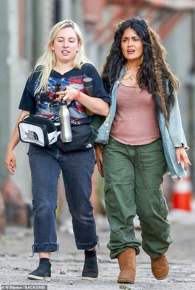 Rough shape: On Tuesday, Salma Hayek was spotted looking a bit of a mess on set of her new film, Bliss, as she walked with a production assistant