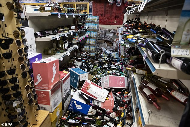 A view of fallen bottles that smashed on the ground after an earthquake, at a gas station and liquor store in Ridgecrest, California