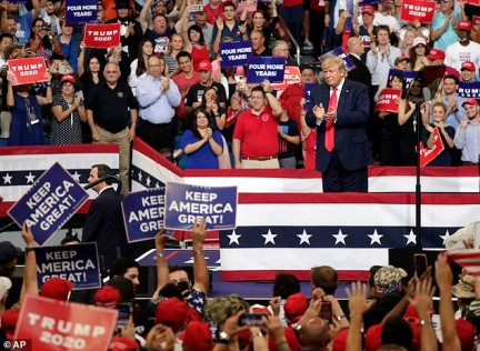 Sir Kim said the audience was a 'sea of the now iconic red MAGA [Make American Great Again] caps. The crowd looked almost exclusively white, with a pretty even mix of men and women, young and old: there were families in every stand. For some, attending had meant a long wait in 30C heat and humidity'