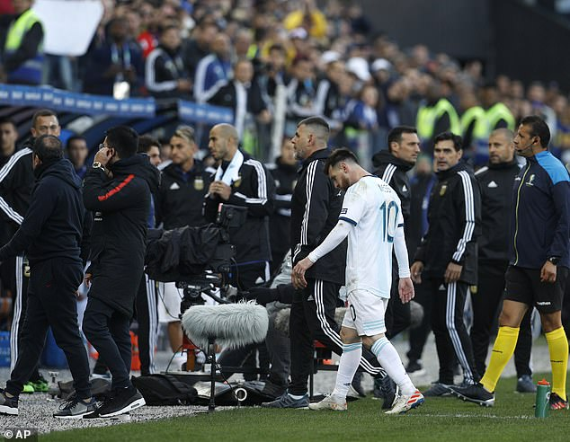 Messi walks back to the dressing room after being sent off during the third place play-off