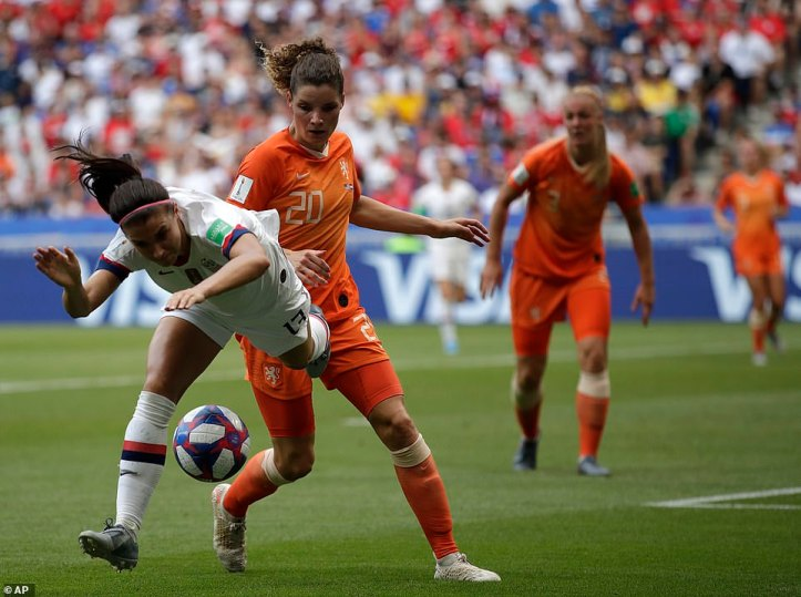 American forward Alex Morgan is dropped to the turf by Dutch defender Dominique Bloodworth