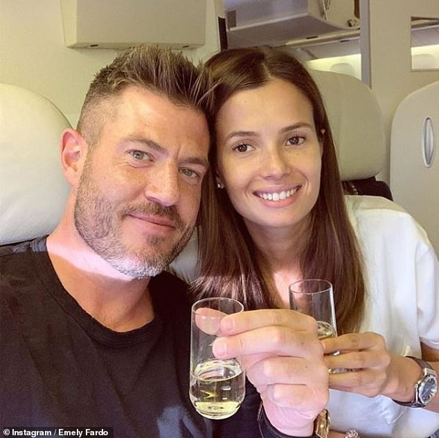 Cheers: The former NFL quarterback proposed to model Emily with a 3.5-carat diamond ring during a surprise trip to France in July 2019 (pictured)