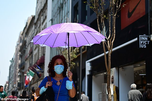 It was already understood that air pollution particles from roads could damage the body. Matters in the energy-producing mitochondria, which helps the heart pump blood around the body. Pictured: A wears face mask against high levels of soot in Mexico