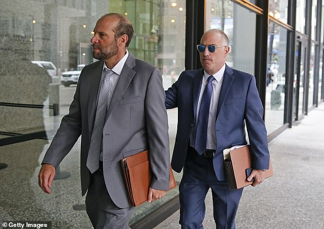 Blue it: Kelly's defense attorney Steve Greenberg (right) arrives at court on Tuesday