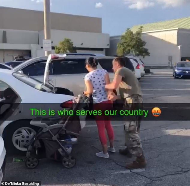 The soldier then focuses his attention on his partner as she tries to calm him down, twisting her arm and slamming her into the trunk of their vehicle