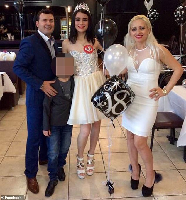 Ms Lekaj (centre) on her 18th birthday with her father Petrit (left) and mother Romina (right)