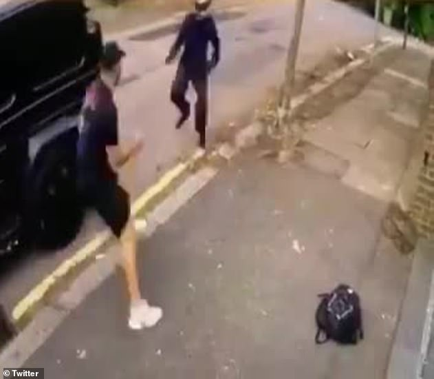 Sead Kolasinac can be seen taking on one of the attackers who wears a helmet and was armed with a knife as he tried to rob him and Ozil - but left empty handed