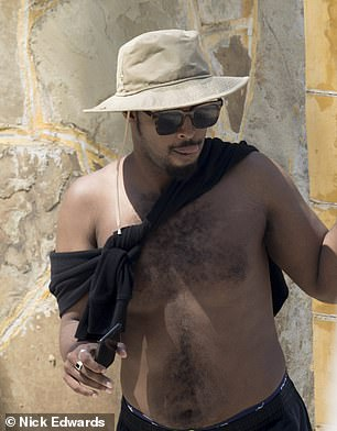 Just this week, DailyMail.com traced Omar's second husband Ahmed Nur Said Elmi, 34, (pictured) down to a beach resort in Mombasa, Kenya and photographed him soaking up the sun on the beach
