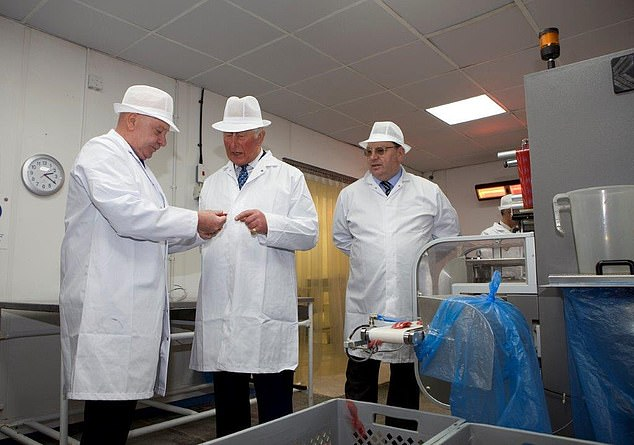 The sweet firm which claims Brexit uncertainty has led to its best-ever sales figures as weary Britons treat them as 'comfort food'. Pictured: Company boss John Winnard (right) and his brother Antony (left), with Prince Charles (centre) earlier this year