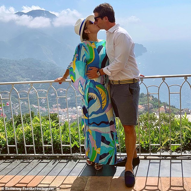 Kisses! The 48-year-old reality star cozied up to Paul while on holiday in Italy as she toasted another year around the sun for her producer beau