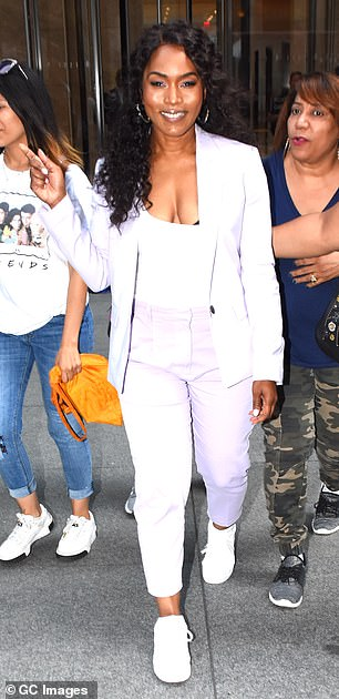 Cool kicks: The Black Panther star completed the look with a pair of white sneakers, which she wore without socks