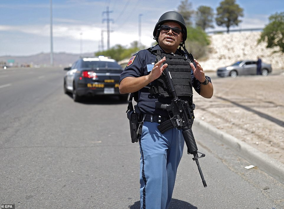 Police stand at attention during an active shooter at a Walmart in El Paso on Saturday