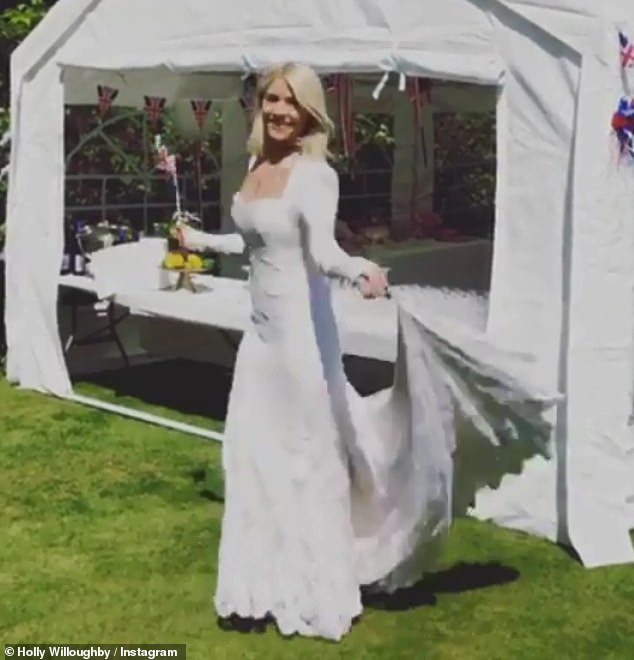 Stunning: Holly created her own wedding dress - an ivory gown covered in French lace - and had a friend make it for her