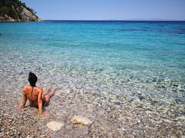 Before arriving on the island of Ikaria Dr Christopher posted a photo of her bathing in waters atLemonakia Beach on the neighbouring island of Samos