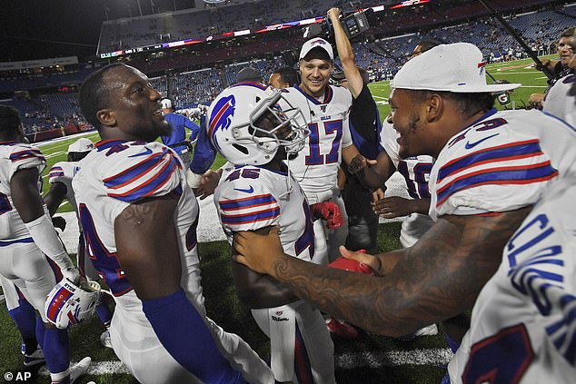 Wade was mobbed by his Bills team-mates after scoring on his first play for the team