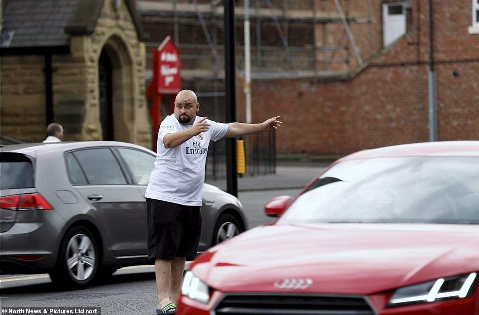 UK Power Networks, who control power lines for London and the South East, and Western Power Distribution in Midlands, the South West and Wales both confirmed widespread outages (pictured, a motorist directing traffic in Gateshead, near Newcastle last night)