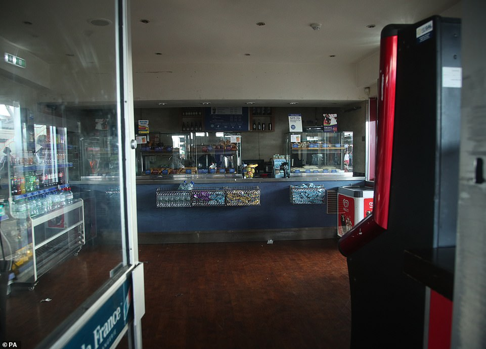 An empty shop in darkness at Clapham Junction station in London during a power cut, which has caused