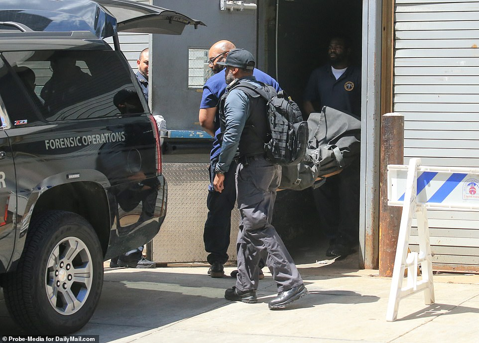 A black bag believed to contain Epstein's body was pictured being taken out of New York Presbyterian-Lower Manhattan hospital on Saturday afternoon