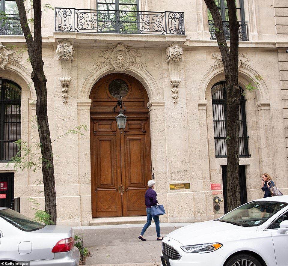 After Epstein's arrest, federal agents raided his $77 million Manhattan townhouse (pictured) where they uncovered hundreds of photographs of naked minors