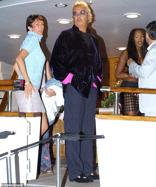 Someone behind Miss Maxwell (left) appears to have the same trousers and top as Miss Roberts, at Naomi Campbell's party in St Tropez, attended by Flavio Briatore (centre)