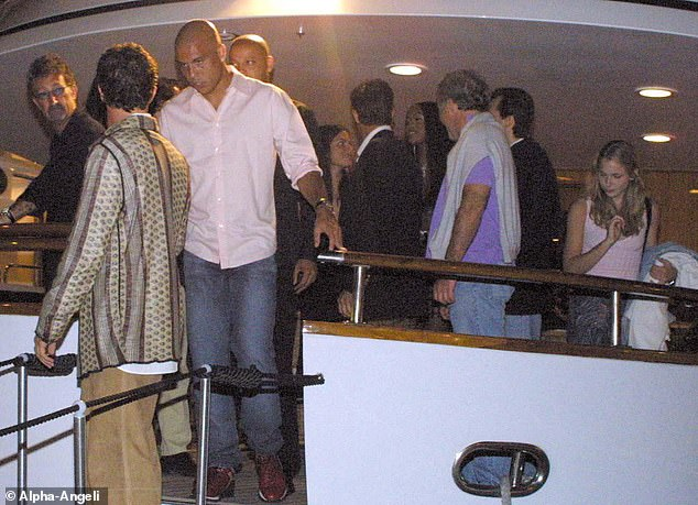 Uncanny: The partygoer is pictured again at the bash (right), which Epstein attended. In legal papers, Miss Roberts said she 'met Naomi Campbell at a birthday party of hers on a yacht in the South of France'. Brazilian footballer Ronaldo is also shown (centre left) and Irish businessman Eddie Jordan (left)