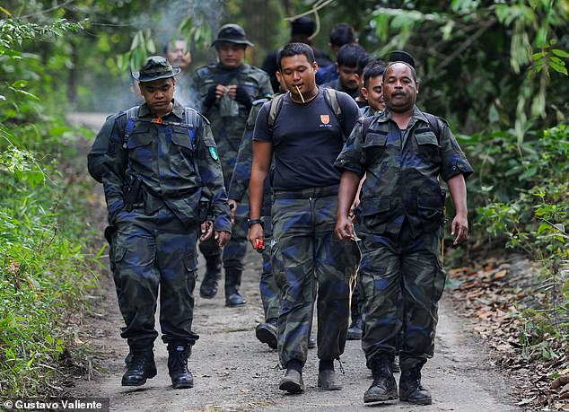 Malaysian General Operations Police arrive at the command post, near the Dusum Resort, today