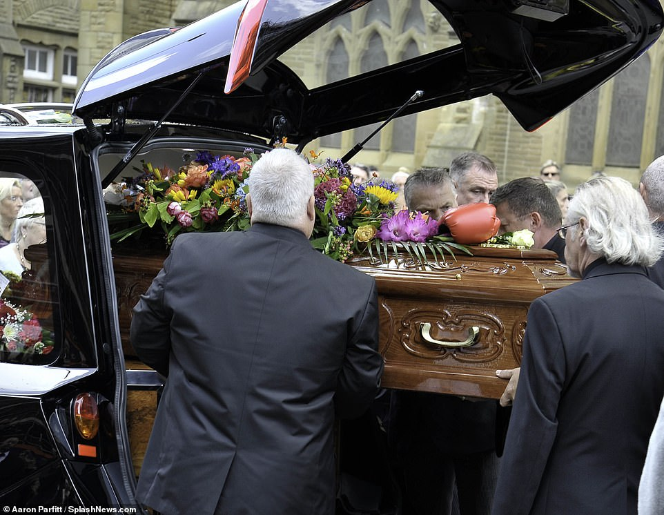 The coffin of Joe Longthorne is carefully removed from the back of a hearse before a service takes place atSacred Heart Church in Blackpool