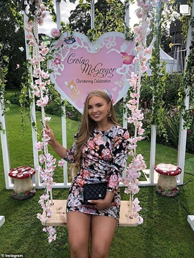 Other guests posed for photographs in front of a 'Croia McGregor sign' on a swing on the lawn of the exclusive castle venue