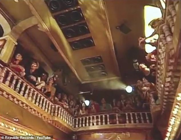Fan club: A happy crowd clusters around the balcony to sing along with the chorus and clap