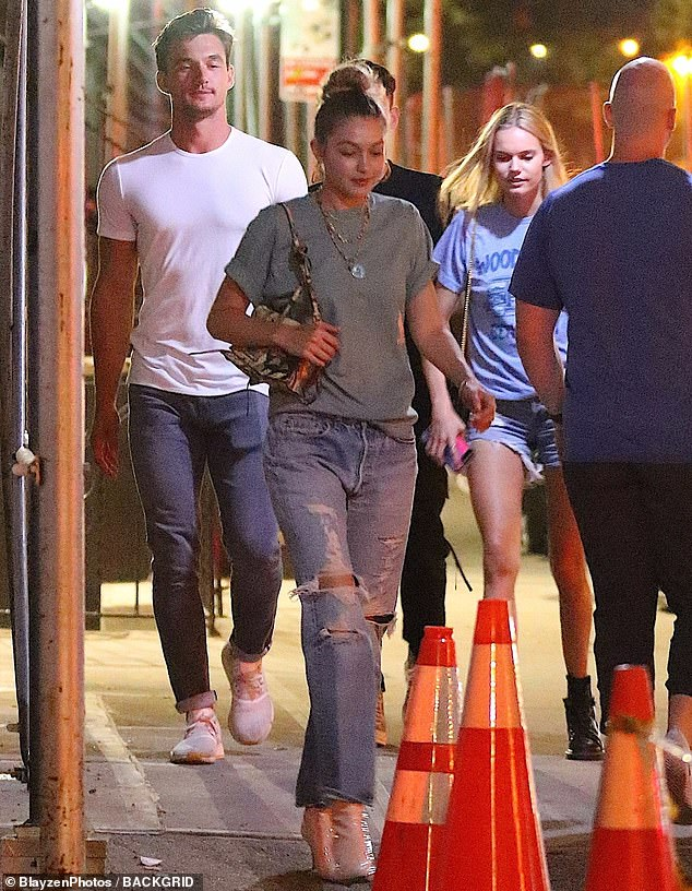 Fuel to the fire: Gigi Hadid was spotted out and about in New York City with The Bachelorette hunk Tyler Cameron and a couple of pals this Tuesday evening