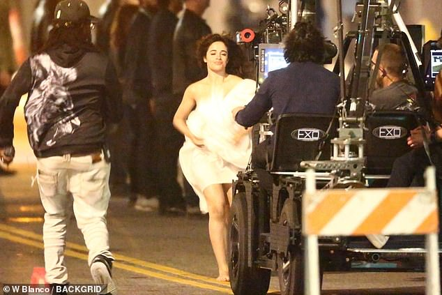 Workaday: At one point, she could be seen gathering her skirts up into her arms as the camera operators approached her in the street