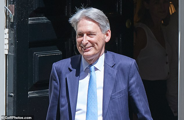 Philip Hammond, the former chancellor pictured in Downing Street on July 24, has penned a letter to Mr Johnson attacking his Brexit strategy