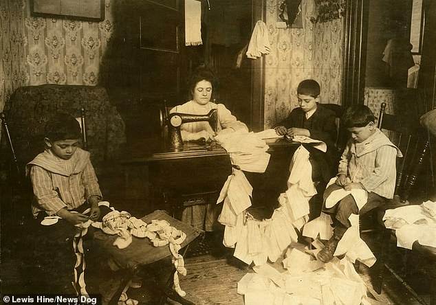 A Romani family make the dresses for Campbell Kid dolls in a dirty tenement room in New York, March, 1912. The children are 12, five and seven years-old. Young children were often employed in menial jobs because it cost less for employers to pay them than adults