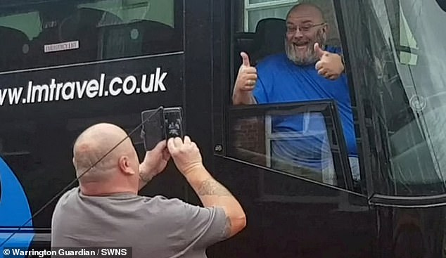 The coach driver was seen trolling his abuser as the angry motorist shouted 'get a proper job' at him during the strange tirade