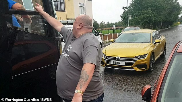Pictured: The motorist rages at a coach driver in Warrington as he branded him 'f***ing scum'