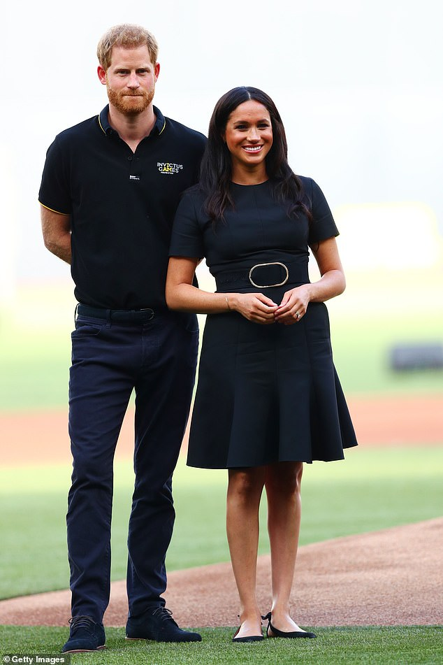 The Duke and Duchess of Sussex reportedly enjoyed a secret trip to Ibiza to celebrate Meghan's birthday this month. They are pictured at the London stadium in June